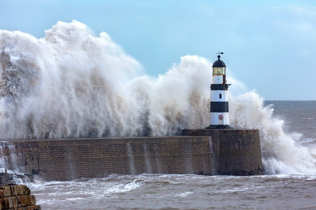 Waves crashing over Seaham Lighthouse on the northeast coast of England.